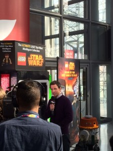 Seth Meyers filming a segment at the Toy Fair