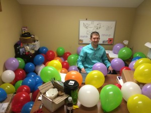It's me, Alex, in a sea of surprise birthday balloons!
